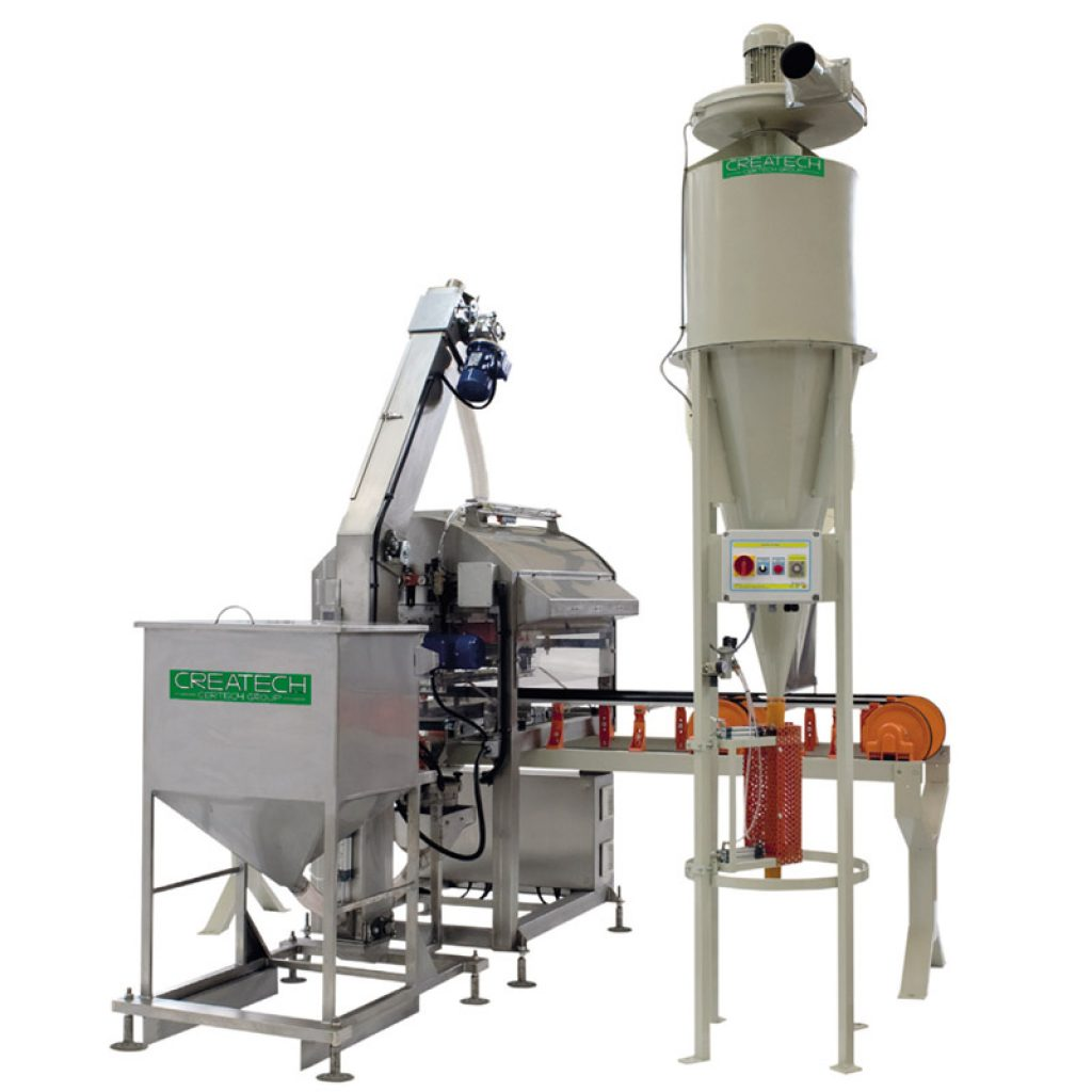 Machine for the application of grits, vetrous products, frits and atomized glazes